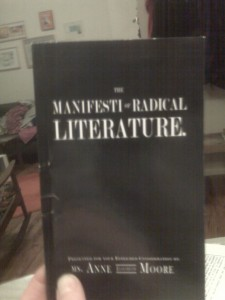 "a black book cover, with white type that reads ""The Manifesti of Radical Literature"""